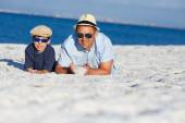 Happy father and son having fun at beach — Stock Photo