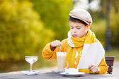 Little boy drinking hot chocolate in cafe — Stock Photo