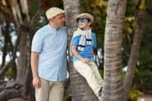 Happy father and son having rest outdoors — Stock Photo