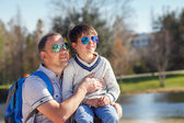 Happy father and his cute little son outdoors — Stock Photo