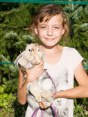 Young girl with pet rabbit — Stock Photo