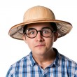 Portrait of a funny young man in a straw hat and sunglasses with — Stock Photo #52385295