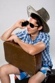 Man with suitcase talking on phone. — Stock Photo