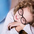 Beautiful girl in glasses with eyes closed dreaming. — Stock Photo #55292511