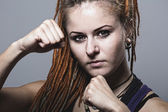 Close-up portrait young woman with dreadlocks in a fighting stan — Foto Stock