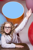 Girl in glasses with hand raised wants to ask — Stok fotoğraf