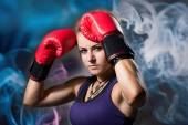Portrait of beautiful girl with red boxing gloves — Foto de Stock