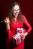 Young woman with two striped gift boxes screams — Stock Photo