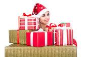 Beautiful christmas woman is holding gift in studio — 图库照片