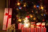 Christmas interior with illuminated Christmas tree and chair. — Stock Photo