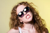 Pretty young capricious beautiful girl in sunglasses  — Stock Photo