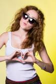 Playful beautiful young woman with sunglasses — Stock Photo