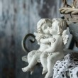 Figurines love angels sitting on a bench — Stock Photo #70886761