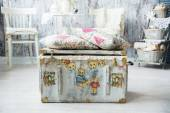 Old chest for toys with painted bears and pillows are.  — Foto de Stock