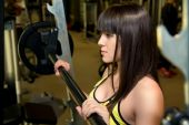 Closeup brunette in the gym. — Stock Photo