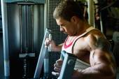 Close-up portrait of a muscular man in the gym.  — Stock Photo