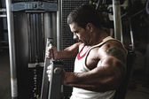 Portrait of a muscular man in the gym — Stock Photo