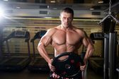 Handsome muscular man in the gym — Stock Photo
