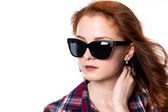 Close-up portrait of red-haired girl with sunglasses looking to — Stock Photo