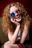 Young girl smiling with curly hair wearing sunglasses with the A — Foto de Stock