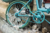 Blue look at ice icicles formed on a parked bicycle. — Stock Photo