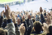 People at stadium — Stock Photo