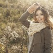 Young girl in autumn scenery — Stock Photo #59798839