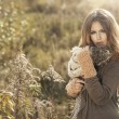 Young girl in autumn scenery — Stock Photo #59798879