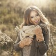 Young girl smiling in autumn scenery — Stock Photo #59809085