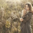 Young girl smiling in autumn scenery — Stock Photo #59809387