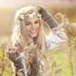 Young girl smiling in autumn scenery — Stock Photo #59816333