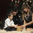 Happy family near Christmas tree — Stock Photo #60598477