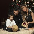 Happy family near Christmas tree — Stock Photo #60598497