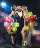 Happy young people celebrating new year's eve — Stock Photo