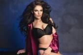 Sensual beautiful brunette woman posing in sexy lingerie, looking at camera. — ストック写真