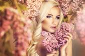 Beauty fashion model girl with lilac flowers — Stock Photo
