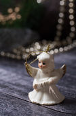 Christmas decoration, Ceramic angel standing on the wood table — Stock Photo