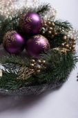Christmas wreath with purple Christmas Balls and Christmas Tree — Stock Photo