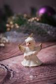 Ceramic angel standing on the wood table — Stock Photo