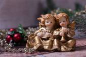Christmas angels singing and playing on the harp and trumpet — Stok fotoğraf