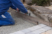 Straighten a paved surface — Stock Photo