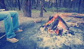 Warming Feet by Campfire Instagram Style — Stock Photo