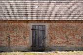 Old brick barn with wooden doors — Stock Photo