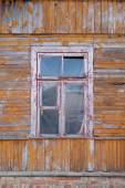 Old wooden house wall with window — Stock Photo