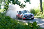 MIKOLAJKI, POLAND - JUL 4: Kevin Abbring and his codriver Sebastian Marschall in a Hyundai i20 WRC race in the 72nd Rally Poland, on July 4, 2015 in Mikolajki, Poland. — Stock Photo
