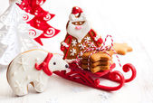Gingerbread polar bear and Santa Claus — Stock Photo