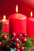 Christmas candles with decor — Stock Photo