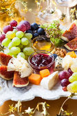 Cheese and fruits platter — Stock Photo