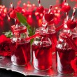 Small bottles with cranberry cocktail — Stock Photo #57677541