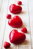 Red glossy hearts — Stock Photo